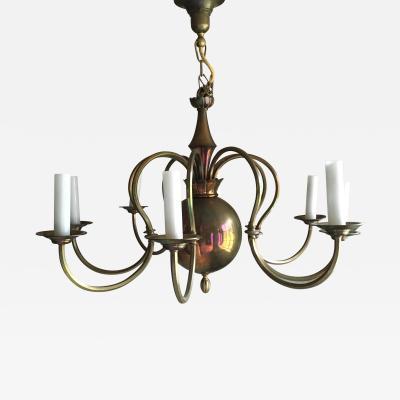 A German Art Deco Eight Light Brass Chandelier