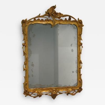 A German Carved and Gilded Openwork Wood Mirror with Original Glass