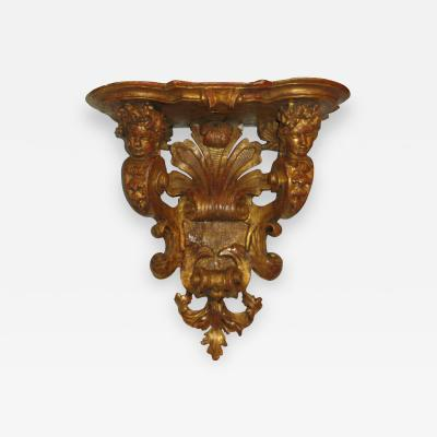 A Gilded Wood Bracket console dapplique