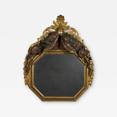 A Giltwood Octagonal Mirror With Floral Painted Canopy Crest