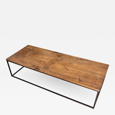 A Good Cherry and Metal Mounted Coffee Table