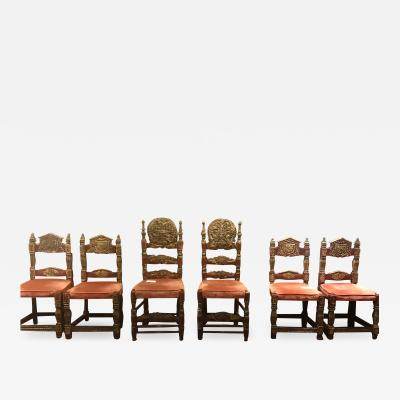 A Harlequin Set of 8 Spanish Colonial chairs