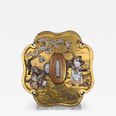 A Japanese Meiji Period gold lacquer tsuba with Shibayama style decoration