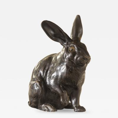 A Japanese Patinated Bronze Sculpture of a Hare Rabbit with Glass Eyes Signed