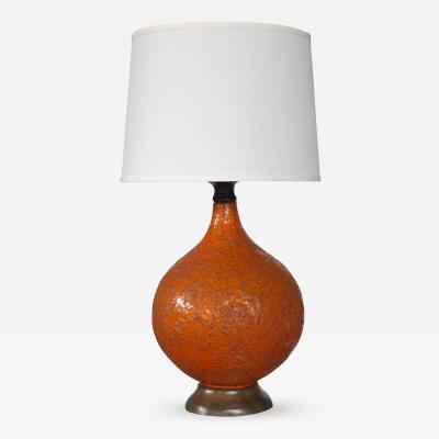 A Large and Iconic American Burnt Orange Crater Glazed Lamp