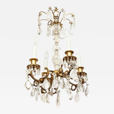 A Louis XV Style Ormolu and Rock Crystal Six Light Chandelier