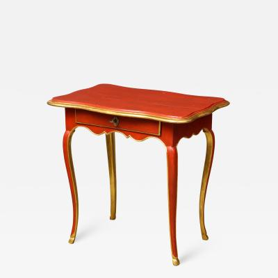 A Louis XV Style Table in Orange with Gold Leaf Accents