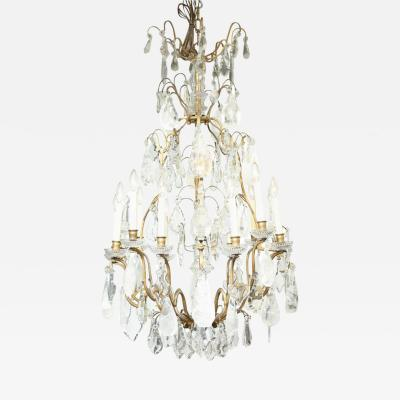 A Louis XV Style Twelve Light Rock Crystal Draped Chandelier