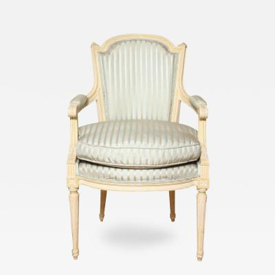 A Louis XVI Style Cream Painted Fauteuil