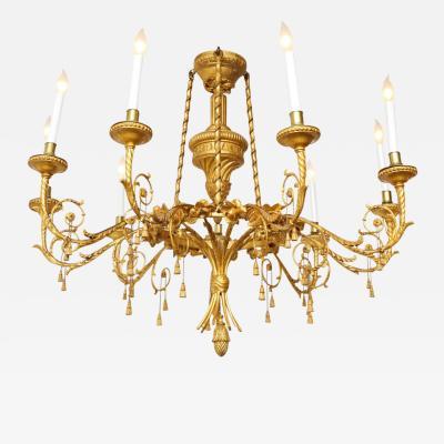 A Louis XVI Style Gilt Wood Eight Light Chandelier