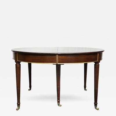 A Louis XVI Style Mahogany Dining Table