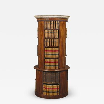 A Mahogany Circular Bookcase With A Statuary Dished Marble Top