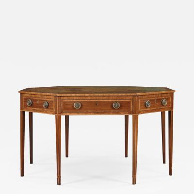 A Mahogany Octagonal and Cross Banded Center or Library Table with Leather Top