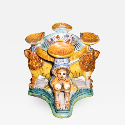 A Majolica Polychrome Salt Cellar with Four Caryatid Lions on a Quatrefoil Base