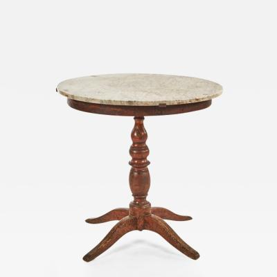 A Marble Top Table on a Simple Oak Base