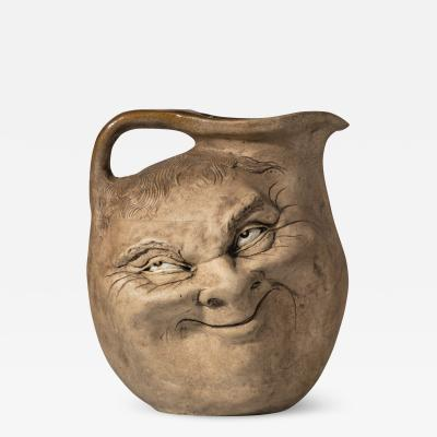 A Martinware double sided stoneware pottery face jug dated 1896