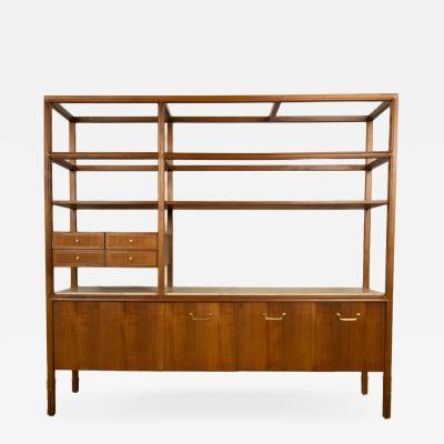 A Mid Century Modern library shelving storage with original travertine top