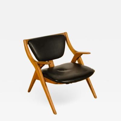 A Mid Century Modern teak lounge chair circa 1950