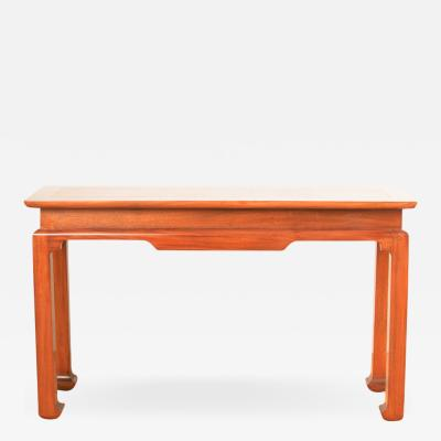 A Mid Century mahogany console in the manner of J Mont circa 1950