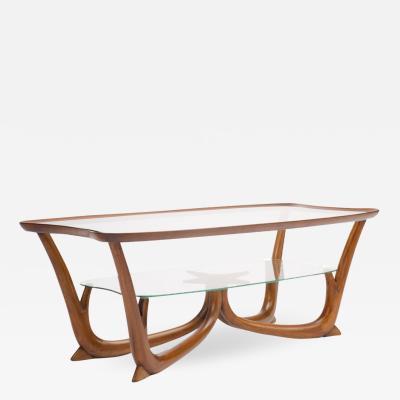 A Modern Italian mahogany coffee table with glass top circa 1950