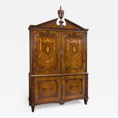 A Neoclassical Armoire With Marquetry Inlay