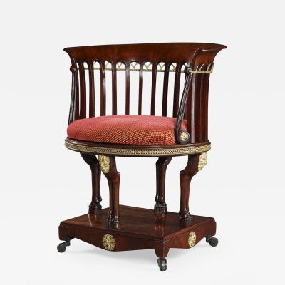A Neoclassical Mahogany And Gilt Bronze Mounted Chair With Integral Footrest