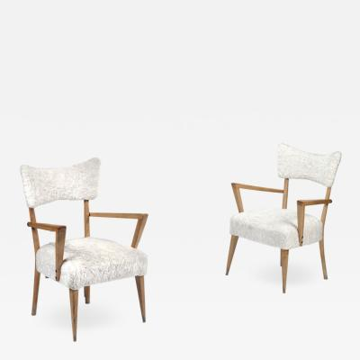 A PAIR OF 1950S FRENCH DESIGN ARMCHAIRS