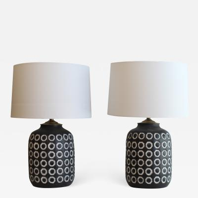 A Pair Of Embossed Ceramic Table Lamps