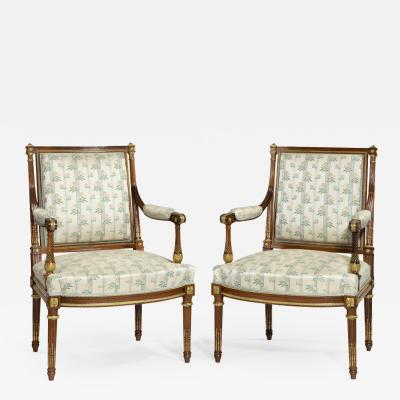 A Pair Of Rosewood Louis XVI Style Open Armchairs
