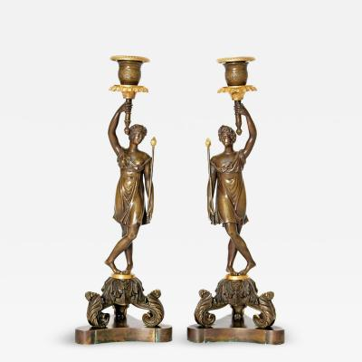 A Pair of 19th Century French Bronze and Gilt Bronze Candlesticks