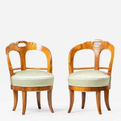 A Pair of Biedermeier Fireside Chairs