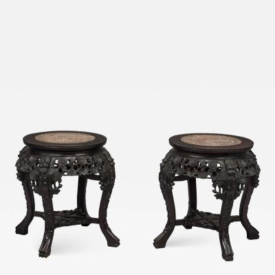 A Pair of Carved Chinese Hardwood Stands