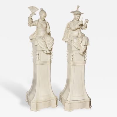 A Pair of Carved Wood Chinese Figures on Pedestals