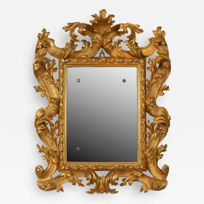 A Pair of Carved and Gilded Baroque Mirrors