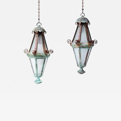 A Pair of Copper Lanterns in an Elongated Diamond Shape with Iron Scroll Bands