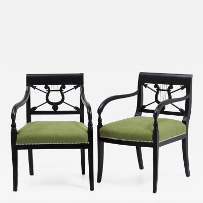A Pair of Ebonised Birch Empire Upholstered Armchairs 1830
