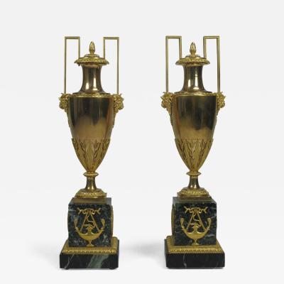 A Pair of French Gilt Bronze Urns