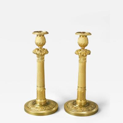A Pair of French Neoclassical Gilt Bronze Candlesticks