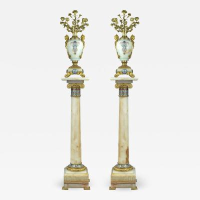 A Pair of French Ormolu and Champlev Enamel Mounted Onyx Torch res