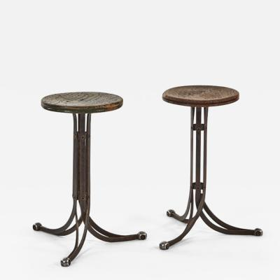 A Pair of Industrial Stools with Metal Base