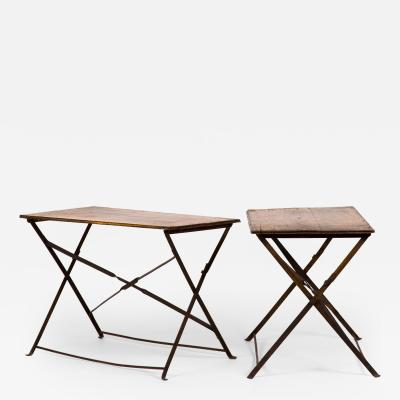 A Pair of Iron Folding Campaign Tables with Wood Tops and Iron Legs