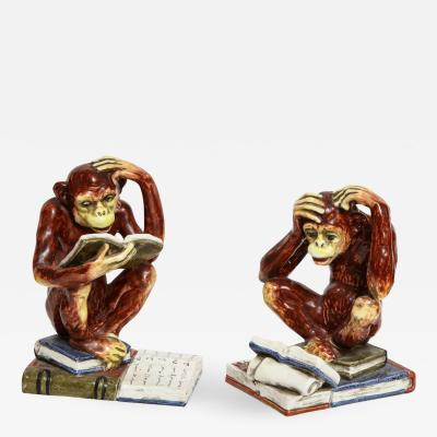 A Pair of Italian Faience Primate Figurines