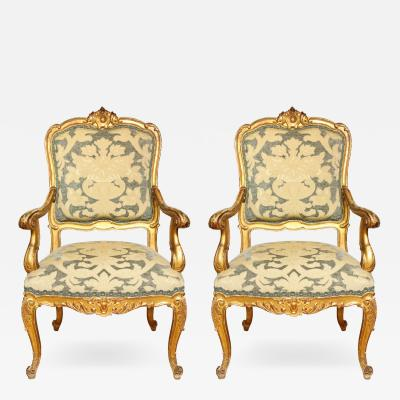 A Pair of Large Scale Italian Rococo Open Armchairs