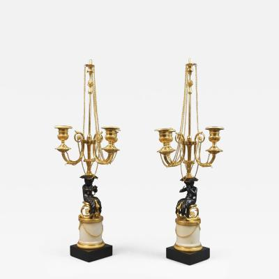 A Pair of Louis XVI Patinated and Gilt Bronze Candelabra on Marble Bases