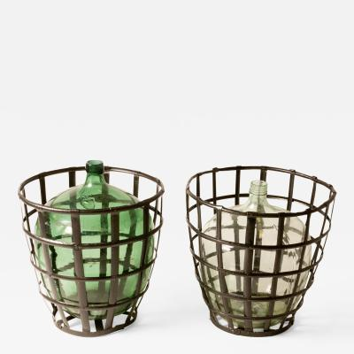 A Pair of Metal Baskets with Bottles