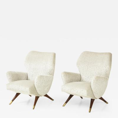 A Pair of Mid Century Style Armchairs