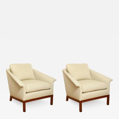 A Pair of Midcentury Lounge Chairs with Walnut Bases