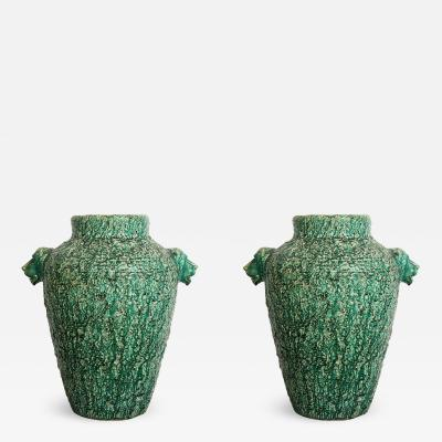 A Pair of Monumental Ceramic Urns