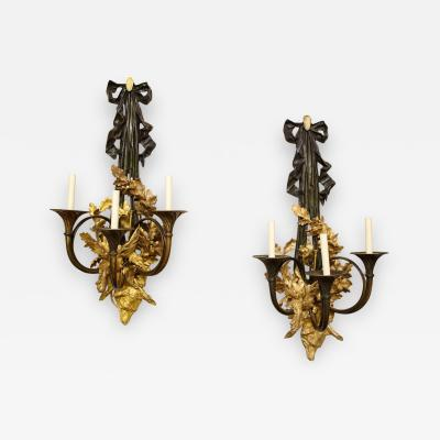 A Pair of Neoclassical Ormolu and Black Painted Three Light Sconce