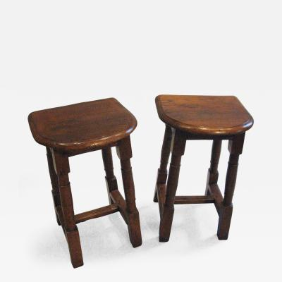 A Pair of Oak Choir or Joint Stools with Shaped Tops and Columnar Legs